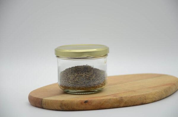 Pot de graines de cumin en vrac